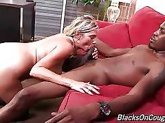 Big boobed blond milf gets fucked by black dude in her office.