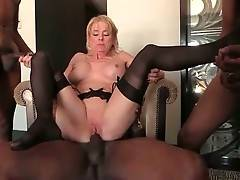 Three Black Studs Share Older White Lady 2