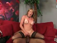 Sexy breasted mature blonde is jumping on insane black cock.