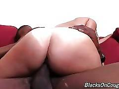 Good looking mature blonde sits down on black dude`s massive cock.