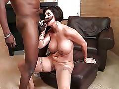 Curvaceous mature slutie is fond of getting poked by black guy.