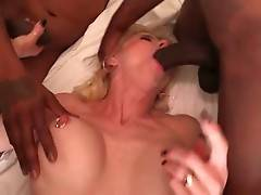 Three horny black dudes are sharing slutty mature blonde.