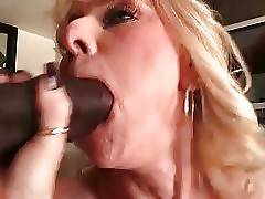 Older big boobed blonde passionately slurps three black dicks.