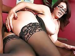 Slutty redhead milf Charlee Chase enjoys huge black dick.