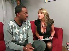 Pretty estate agent Shayla LaVeaux shows neighborhood to her black client.