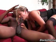Breasted mature blonde hungrily swallows partner`s huge black dong.
