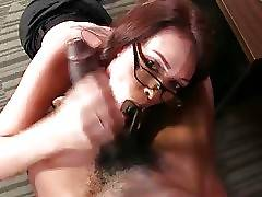 Nasty curvaceous milf gives young black stud skillful blowjob.