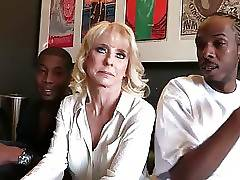 Pretty blond milf Cammille has to solve a problem with three black guys.