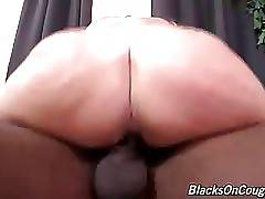 Curvaceous older hooker is jumping on massive black dick.